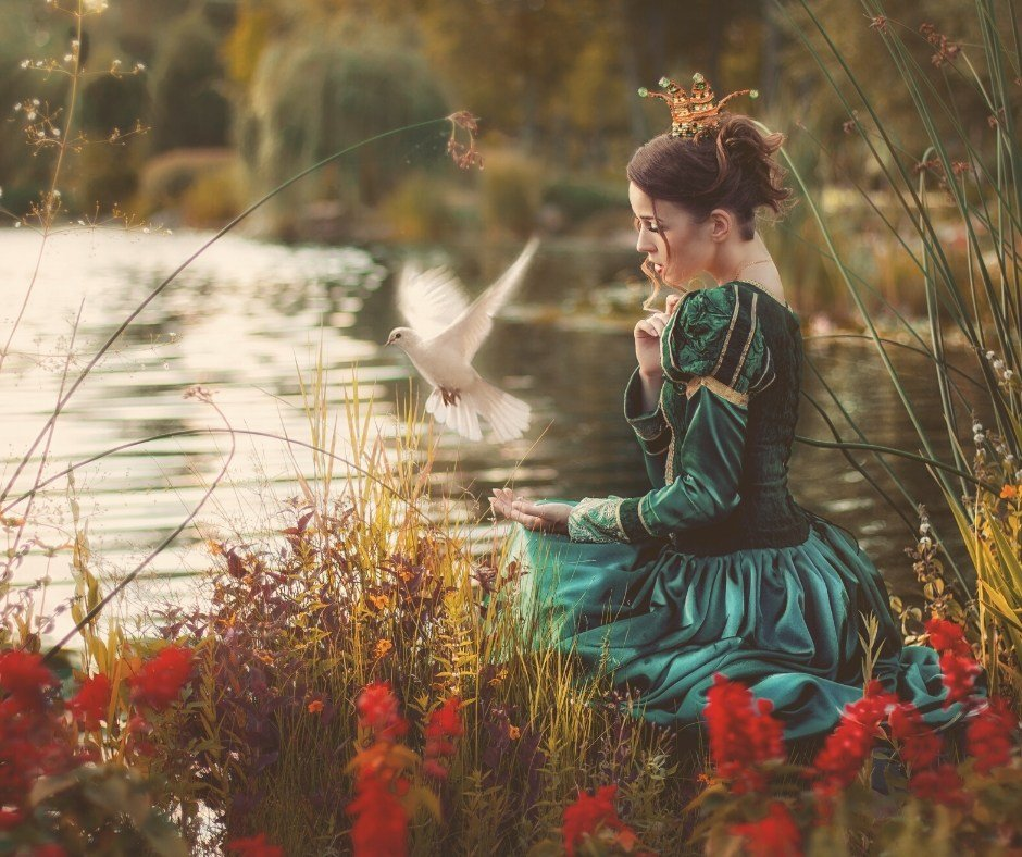 Princess sitting by the lake with a bird